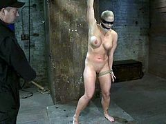 Stunning Holly Heart gets blindfolded and tied up. A guy also puts the stocking on her head. Then he also toys her vagina.