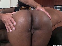 This dark-skinned nympho is an extremely hot and dirty type of a woman. She has a fat ass that's just begging to get fucked hard in every possible position. Damn, that big ass of hers drives me insane!