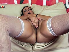 Filthy slut with big saggy boobs strips in front of camera. She spreads her legs wide apart exposing hairy pussy in all the glory. She stretches her pussy lips with fingers showing her depth.