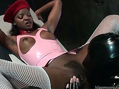 Black appetizing girl enjoys pussy eating of one wild babe wearing latex cat outfit. She munches her lips and tickles her clit with her playful tongue.