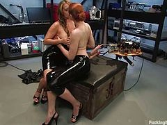 See the busty lesbians Sabrina Fox (the redhead) and Trina Michaels (the blonde) as they have fun playing with fucking machines.