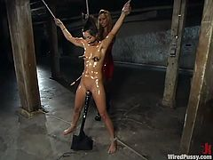 Amazingly hot brunette chick gets tied up by her sexy mistress in latex dress. She gets her pussy toyed with a vibrator and ass with a dildo at the same time.