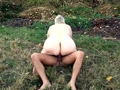 Outdoor scene with that wild and horny granny that rides long and stiff cock after she made it like that with perfect blowjob and handjob.