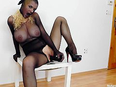 This blonde babe takes out her finest nylons and puts a pair of her face. She is completely covered in nylons and she sticks a huge dildo in her mouth before tearing open her stockings and shoving it inside her pussy.