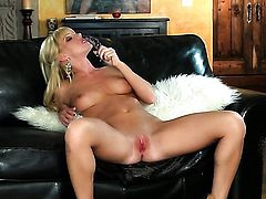 Niki Young does striptease before she sticks vibrator in her hole