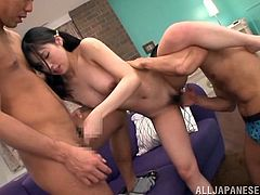 Asian babe Yuki Komiyama with fancy pigtails and natural tits fucking missionary with two guys. She gets cum in mouth at the end.