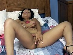 Shapely Latina whore with curvy body lies in her big bed all naked and rubs her ass crack. Then juicy brunette bitch spreads her legs wide open and fucks her shaved cunt with big dildo.