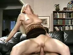 Slutty blonde milf Nicole Moore kneels in front of some guy and favours him with a terrific blowjob. Then she sits down on the prick and fucks the dude in cowgirl position.