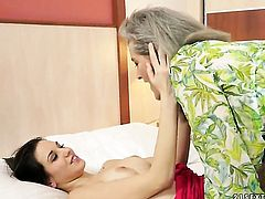 Brunette Candy Sweet with giant hooters is in the mood for lesbian sex and spreads for Aliz