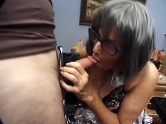 This horny granny in glasses get what she wants long time ago, handsome son's friend. She blows his dick to make it hard for hardcore sex and swallow