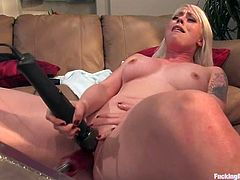 Nasty blonde Lorelei Lee takes her red lingerie off and rubs her vag with a toy. Then she spreads her legs wide and gets her twat drilled by a fucking machine.
