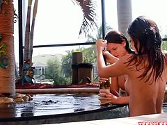 Beautiful tall lesbian twin girls swimming in the pool and getting naughty with each other! Watch them rubbing their sweet titties! One girl pours oil on the other and massages it all over her body!