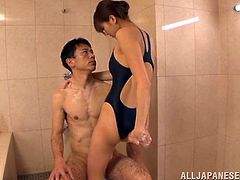 Beautiful Japanese girl in a swimsuit rubs her ass against a dick. She also gives a titjob and gets her pussy licked through the swimsuit.