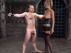 Kinky blonde girl in stockings and corset ties Andy Mann up and fixes claws to his nipples. Then she also tortures his dick with ropes.