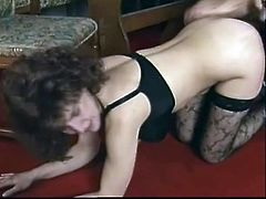 Brown-haired bitch Margareta wearing stockings is having fun with some stud indoors. She sucks the guy's boner and lets him lick her big natural tits and then they fuck in side-by-side position on the floor.