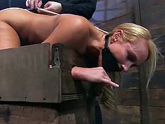 Mellanie Monroe gets tormented and splattered with hot wax