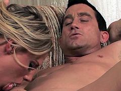 Smoking hot tanned blonde bimbo Charisma Cappelli with big fake tits and awesome ass in booty shorts gives head to to Billy Glide and rides on his cock like crazy.