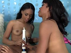 There is some girl and girl action is happening here and they are fucking hot. They undresses one another and then one of them's pussy is being vibrated with a white vibrator while the other one is fingering her pussy. She is enjoying the buzz of that toy and lick in her tight vagina at the same time.