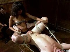 Horny chick tortures guy's dick with claws and drills his ass with a strap-on. Later on she sucks several dicks in hot BDSM video.