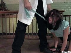 Hot brunette girl gets whipped and humiliated. After that she gets tied up with straps and pounded on a table.