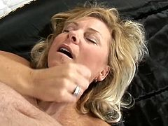 Press play on this amateur scene and watch this horny grandma having fun sucking and riding a guy's stiff cock as you hear her moan.