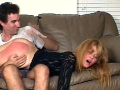 Watch this guy getting a hold of his wife's big round ass to spank it as you her this milf moan with pleasure.