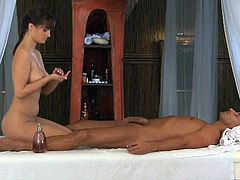 Pretty brunette massages her man's dick and rubs it against her pussy. Then she takes the schlong into her vagina and fucks the man in the reverse cowgirl position.