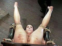 Kinky brunette babe gets tied up in acrobatic pose. Then a guy spanks her ass and toys her vagina. He also fingers her pussy to make her cum.
