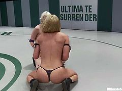 Ashley Jane and Krissy Lynn are two pretty blonde babes. They are not good wrestlers, but they are very sexy. After the battle the winning blonde toys the other babe with a strap-on.