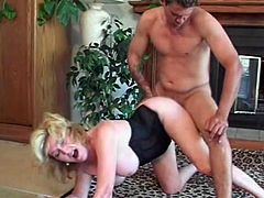 When her son's friend came to their house, this mature broad immediately pulled out his prick and started to suck and ride it in a pro style