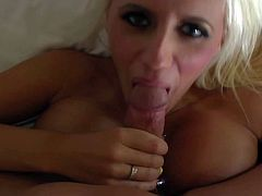 Pretty blonde bimbo Jacy Joy with long yellow whorish nails and huge juicy melons has big smile on face while giving titjob to tattooed Derrick Pierce in point of view.