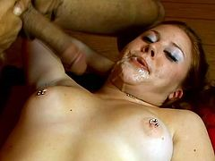Redhead chick with pierced nipples lies down on a couch and gives hot blowjob. She also fondles her shaved pussy while sucking a dick.