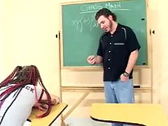 Take a look at this redhead teen's perfect round ass being spanked by her teacher as she interrupts her class.