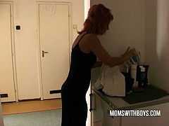 Watch this sexy and horny redhead stepmom catches his yo
