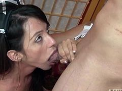 Ariella Ferrera the MILF in maid uniform has fun with Eric Jover. He licks her armpits and then she gives him a blowjob.