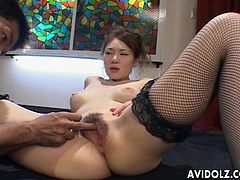 This super sexy AV model has her legs spread open by her sex slave and he sticks his fingers in her hairy pussy. He takes two fingers and spreads her pussy lips open so you can see deep inside her pink pussy.