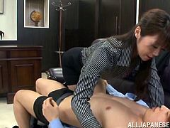 Japanese Maki Hokujo blows and gets fucked from behind in an office