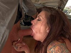 Turned on wild brunette bombshell Mason Moore with enormous jaw dropping knockers and colorful arm tattoo in high heels gives head to her lover and gets licked good in abandoned garage.