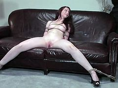 Astonishing girl Amber Keen is having fun with a man in the living room. The dude restrains the chick and toys her awesome pussy till she gets an orgasm.