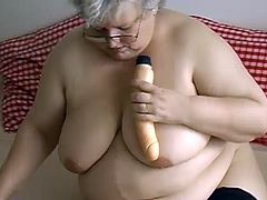 Filthy tome worn SSBBW granny shows off her ginormous saggy tits. Old fat whore takes off her panties and rams her fat shaved cunt with big plastic dildo.