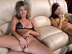 Asian bitch Annie Cruz and hot blonde milf Brianna Beach are having some nice time on a sofa. They finger their sweet pussies and then smash them with dildos.
