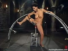 Brunette cutie Mia Bangg is getting naughty in a basement. She gets bound by some guy and then enjoys playing with a fucking machine.