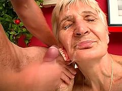 Weird short-haired blonde granny called Irene favours her man with a blowjob. Then she rubs her hairy twat with her artificial teeth and gets her pink cave drilled hard.