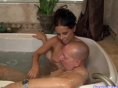 Brandy give her guy a nice bathing experience. She jerks and sucks his cock in the bathtub and then massages him with her boobs. The sensual brunette whore knows how to make a guy feel good and deserves cum for that! Look at those big boobs, will she get them cum glazed?