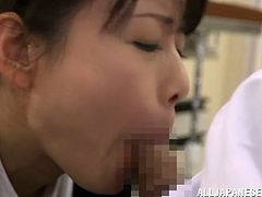 Man, she is a hungry Japanese nurse on duty! Babe gets down on her man's cock and treats him right away! That blowjob is worth watching.