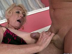 Alothough she is a woman at certain age she still knows how to please a man in bed. She sucks this stud's stiff cock greedily like a dirty whore.