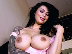 Fantastic tattooed brunette Tera Patrick is getting naughty on the stairs. She takes her dress off and sits down on the steps to masturbate her coochie.