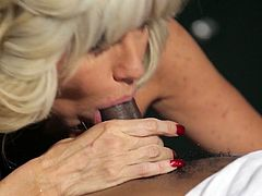 This mature woman with big boobs wants to know what it feels like to suck a massive, black cock and today is her lucky day. She sucks his long dick like a pro. Then she wants him to return the favor and eat her delicious snatch.