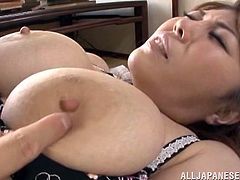 This brunette Japanese milf wants to please her husband. He squeezes her massive melons and then, slaps his dick on her tits. Watch, as she gives an amazing titjob. His tiny dick is engulfed in her huge boobs.