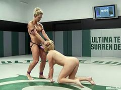 Two nasty blondes Krissy Lynn and Holly Heart are getting naughty on tatami. They fight with each other ardently and then the winner fucks the loser's pussy with a strapon.